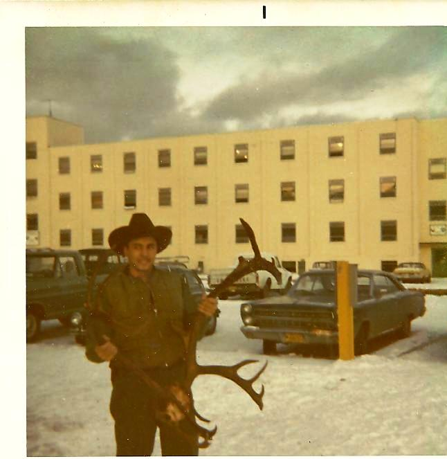 bill-sheka-holding-a-nice-caribou-he-shot-next-to-the-infamonou-hhc-barracks-behind-the-cars-is-atc-and-northernwarfare-training-center-the-usarmy